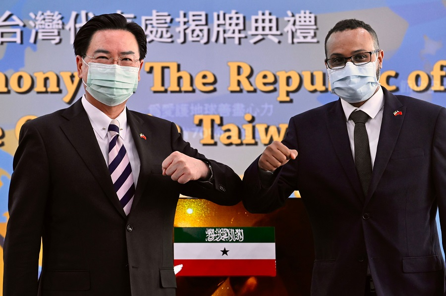 Mohamed Hagi (right), Somaliland's Taiwan representative, bumps elbows while posing with Taiwan's Foreign Minister Joseph Wu during the opening ceremony of the Somaliland representative office in Taipei on 9 September 2020. (Sam Yeh/AFP)