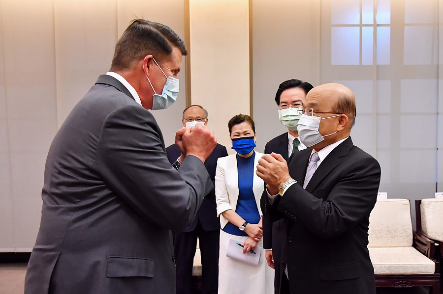 This handout picture taken and released by Taiwan's Executive Yuan on 18 September 2020 shows US Undersecretary of State Keith Krach (left), greeting Taiwan Premier Su Tseng-chang (right) at the Executive Yuan in Taipei. (Handout/Taiwan Executive Yuan/AFP)