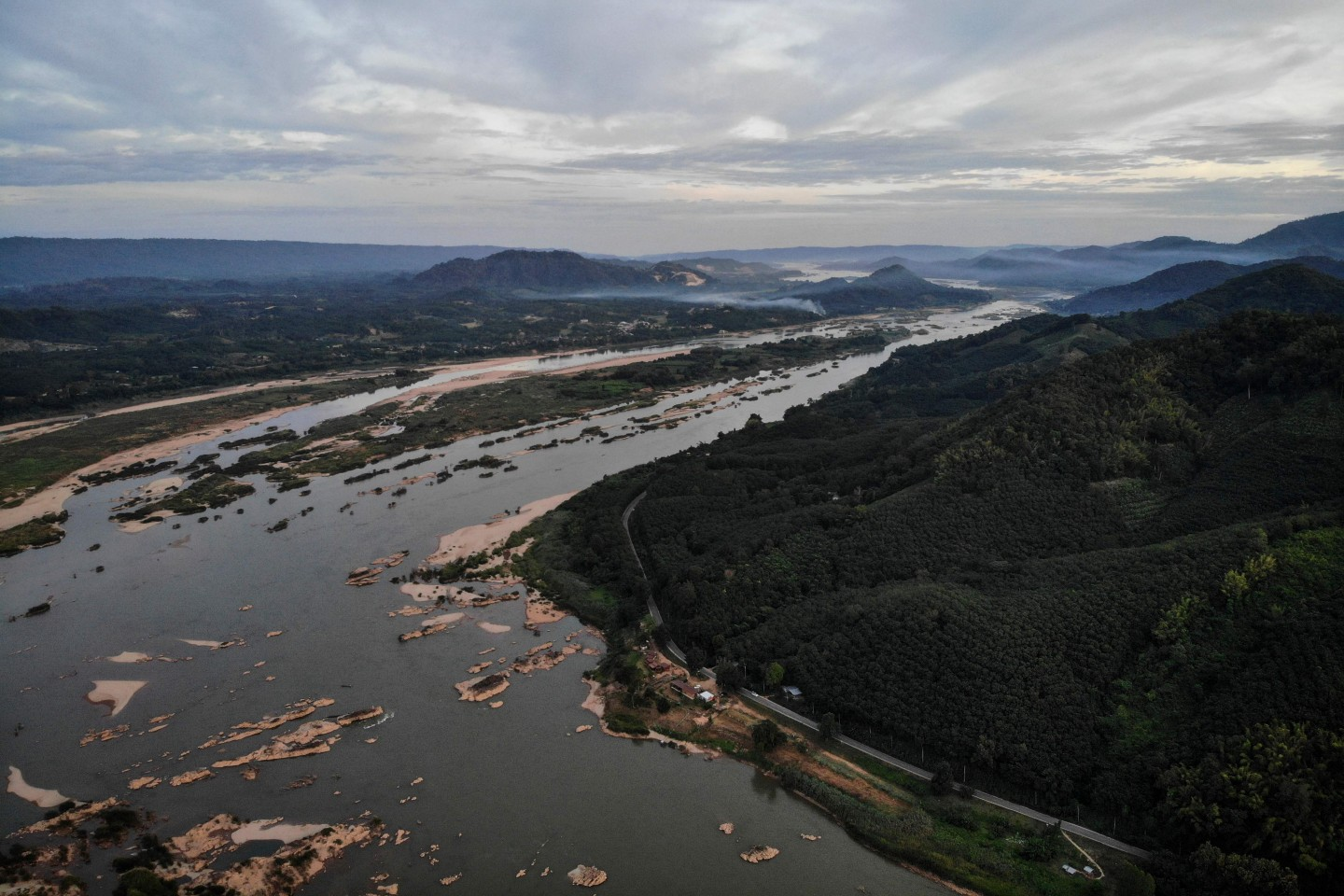 This aerial photo shows the Mekong River at Sangkhom district in the northeastern Thai province of Nong Khai, with Laos seen on the left, on October 31, 2019. (Lillian Suwanrumpha/AFP)