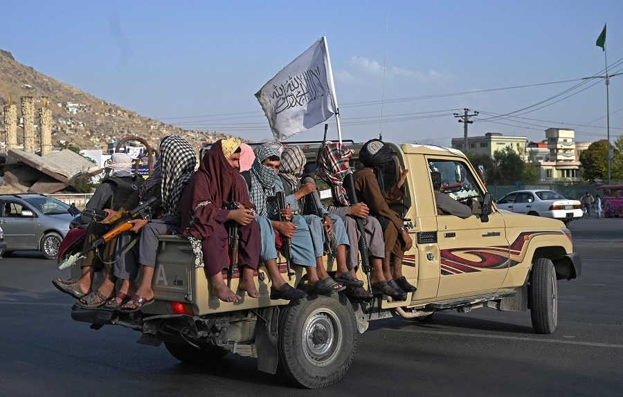 Taliban fighters in a vehicle patrol the streets of Kabul, Afghanistan, on 23 August 2021 as in the capital, the Taliban have enforced some sense of calm in a city long marred by violent crime, with their armed forces patrolling the streets and manning checkpoints. (Wakil Kohsar/AFP)