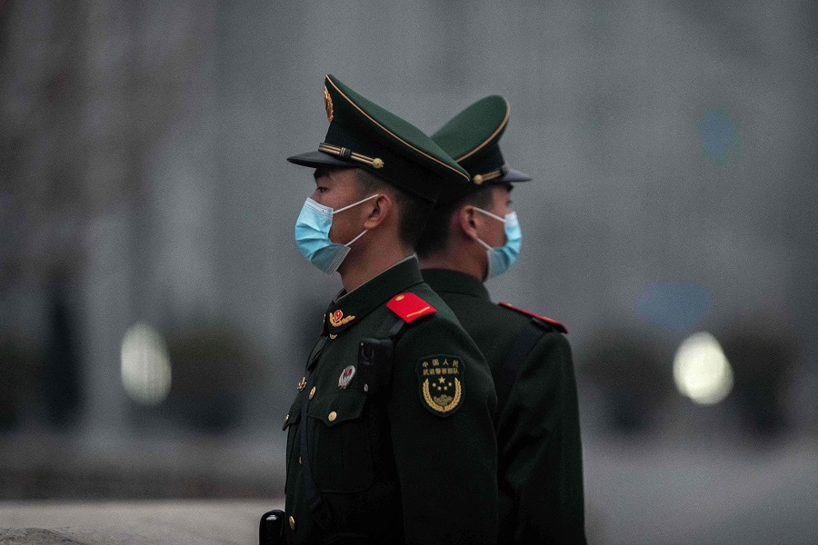 Chinese soldiers stand guard near Tiananmen Square in Beijing, China, on 5 March 2021. (Nicolas Asfouri/AFP)