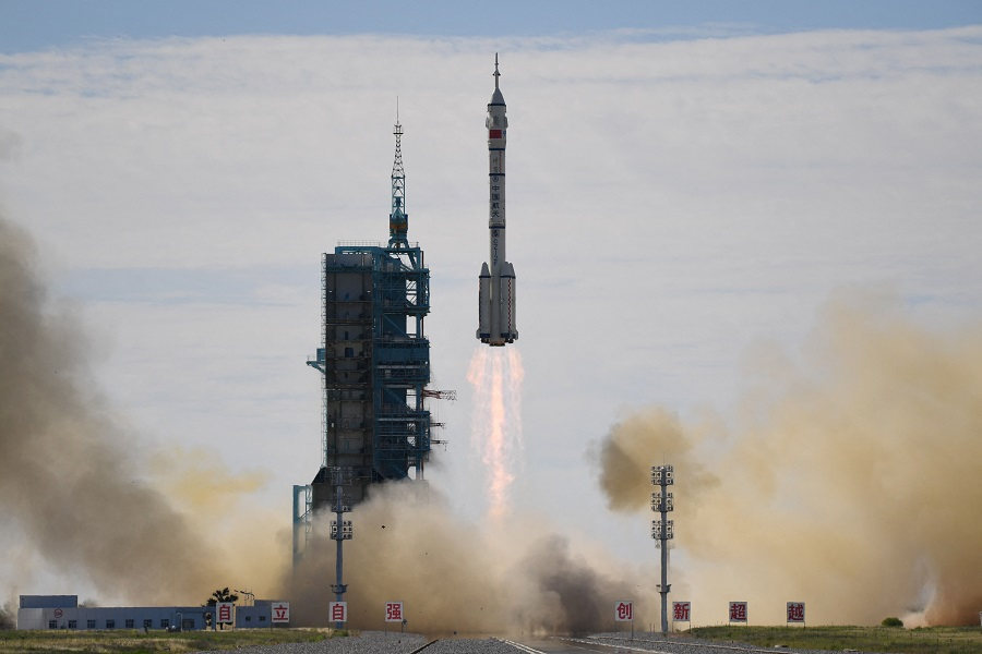 A Long March-2F carrier rocket, carrying the Shenzhou-12 spacecraft and a crew of three astronauts, lifts off from the Jiuquan Satellite Launch Centre in the Gobi desert, China, on 17 June 2021, the first crewed mission to China's new space station. (Greg Baker/AFP)