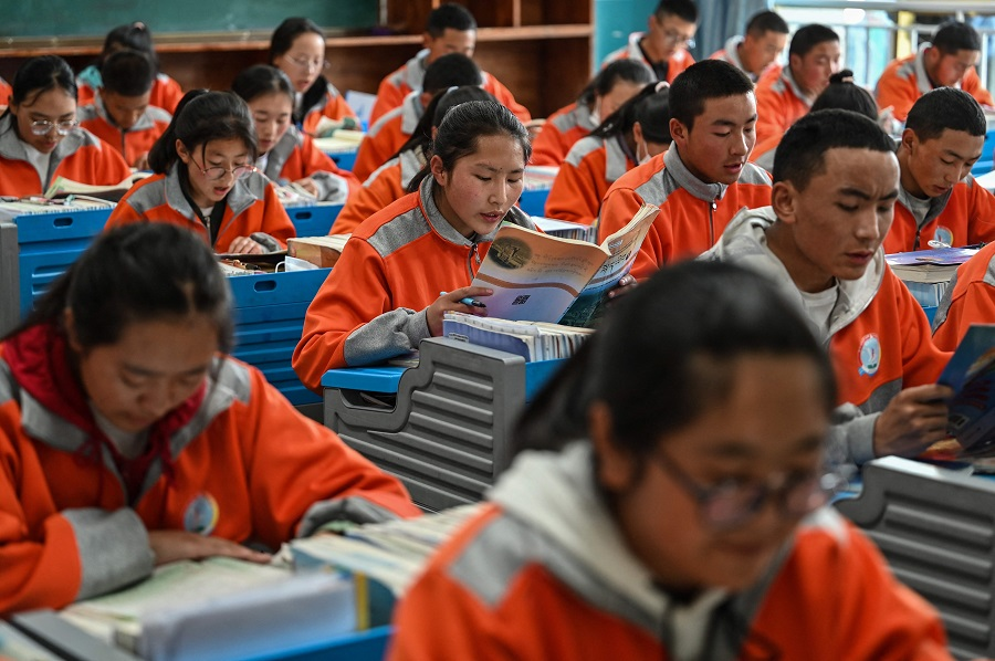 This photograph taken during a government organised media tour shows students in a classroom at the Lhasa Nagqu Second Senior High School in Lhasa, Tibet Autonomous Region, China, on 1 June 2021. (Hector Retamal/AFP)