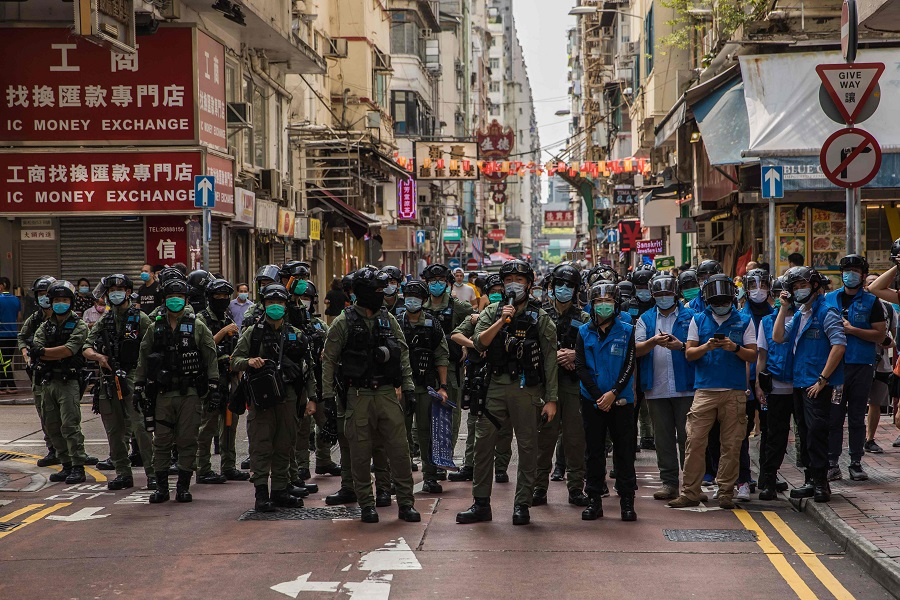 Police patrol the area after protesters called for a rally in Hong Kong on 6 September 2020 to protest against the government's decision to postpone the legislative council election due to the Covid-19 coronavirus, and the national security law. (Dale De La Rey/AFP)