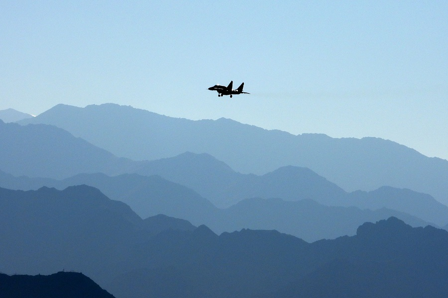 An Indian Air Force fighter jet flies over a mountain range in Leh, the joint capital of the union territory of Ladakh bordering China, on 15 September 2020. (Mohd Arhaan Archer/AFP)