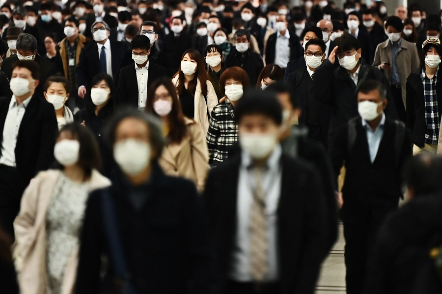 People commute to work at Shinagawa station in Tokyo, Japan, on 16 April 2020. Japan is handing out ¥100,000 to all citizens for virus relief. (Charly Triballeau/AFP)