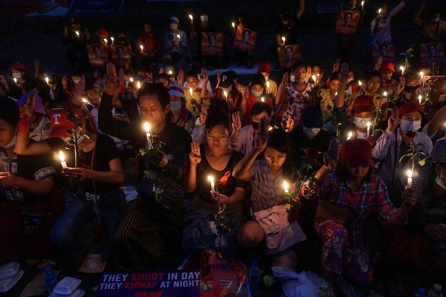 Protesters hold a candlelight vigil outside the US Embassy during a demonstration against the military coup in Yangon, Myanmar, on 21 February 2021. (Sai Aung Main/AFP)