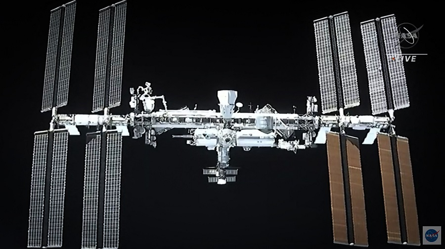 This screen grab taken from the NASA live feed shows the International Space Station taken from the SpaceX's Crew Dragon spacecraft before docking, on 24 April 2021. (NASA/AFP)