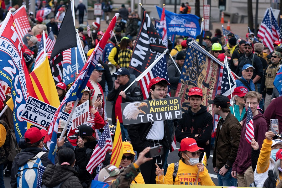 Supporters of US President Donald Trump rally at Freedom Plaza in Washington, DC, on 12 December 2020, to protest the 2020 election. (Jose Luis Magana/AFP)
