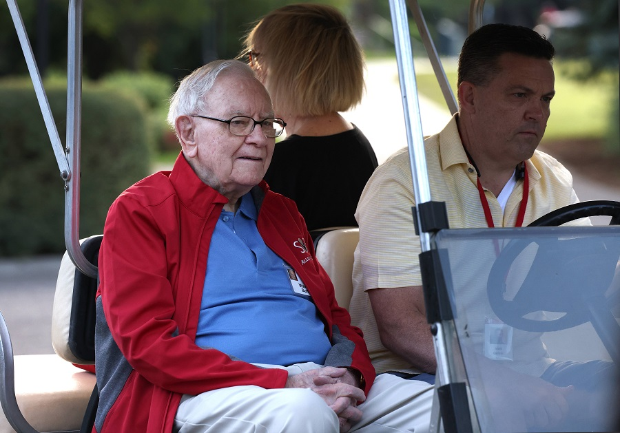 Chairman and CEO of Berkshire Hathaway Warren Buffett rides in a golf cart at the Allen & Company Sun Valley Conference on 7 July 2021 in Sun Valley, Idaho, US. (Kevin Dietsch/Getty Images/AFP)