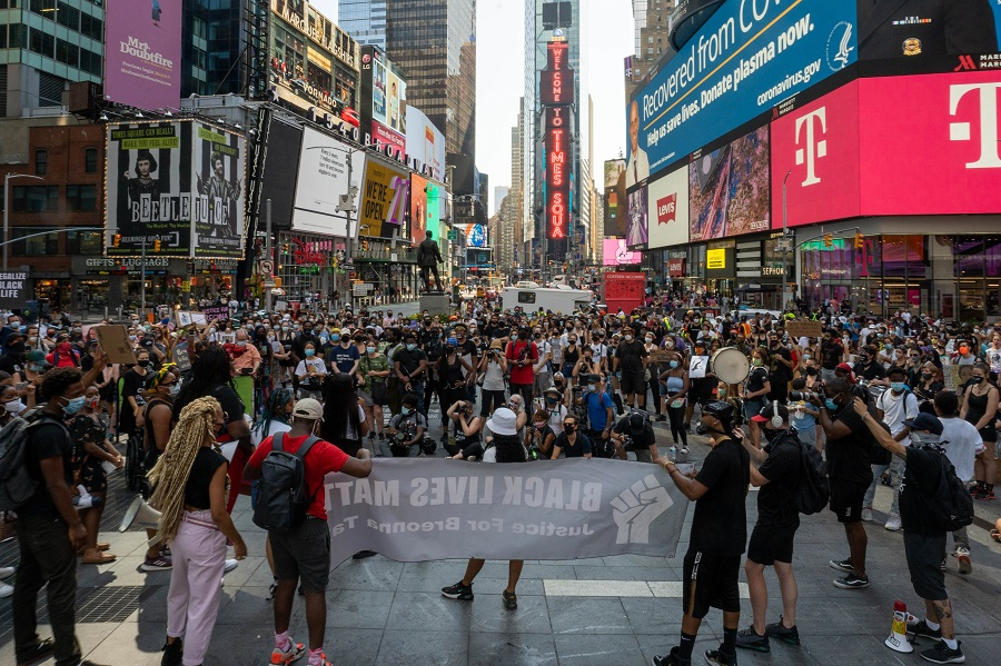 BLM protesters gather at Times Square to march uptown via the Henry Hudson Parkway on 9 August 2020 in New York City. (David Dee Delgado/Getty Images/AFP)