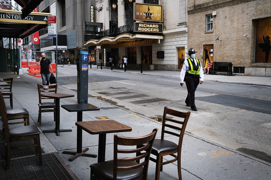 Broadway theaters stand closed along an empty street in the theater district on 30 June 2020 in New York City. (Spencer Platt/Getty Images/AFP)