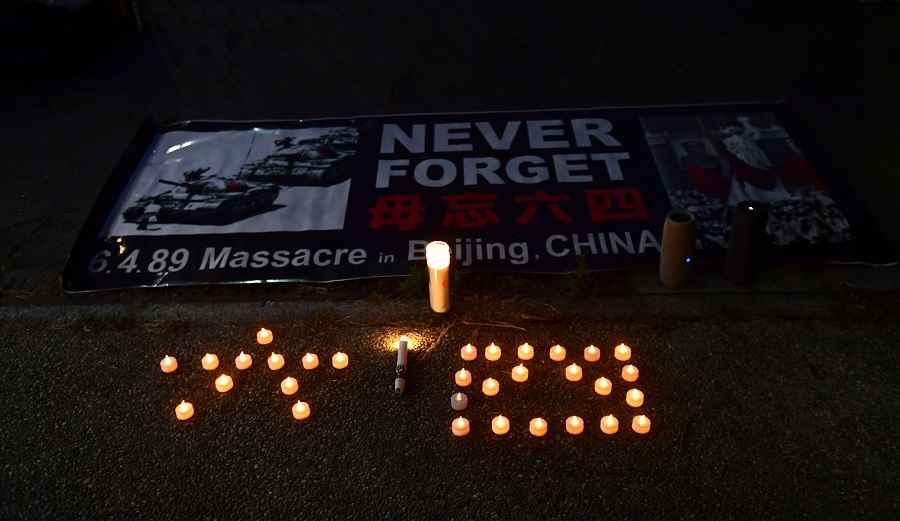 """Candles are placed in the Chinese characters for """"6"""" and """"4"""" during a vigil across the road from the Chinese consulate in Los Angeles, California on 4 June 2020, where activists gathered to commemorate the 31st anniversary of the 1989 June 4 Tiananmen Square protests in Beijing, China. (Frederic J. Brown/AFP)"""