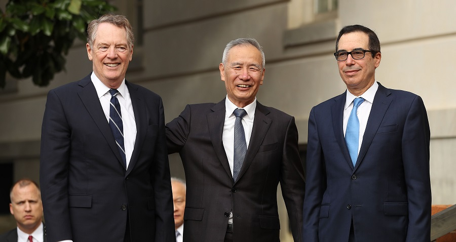 Chinese Vice Premier Liu He (C) poses for photographs with U.S. Trade Representative Robert Lighthizer (L) and Treasury Secretary Steven Mnuchin at trade negotiations in Washington in October 2019 (Chip Somodevilla/Getty Images/AFP)