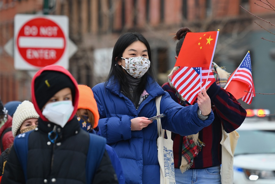 People celebrate the Lunar New Year holiday in Chinatown on 12 February 2021 in New York City, US. (Angela Weiss/AFP)