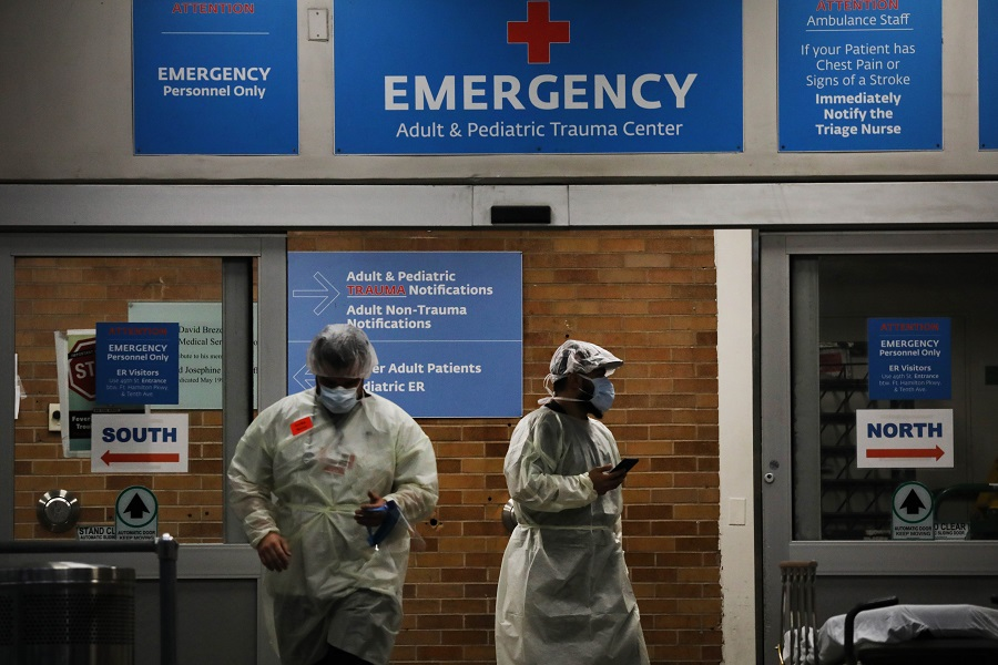 Medical workers take in patients outside a special coronavirus area at Maimonides Medical Center on 6 May 2020 in the Borough Park neighborhood of the Brooklyn borough of New York City. (Spencer Platt/Getty Images/AFP)
