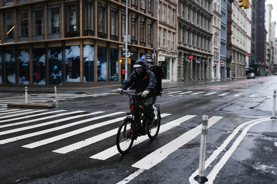 Streets stand nearly empty in the popular Manhattan shopping district of Soho on 26 April 2020 in New York City. (Spencer Platt/Getty Images/AFP)