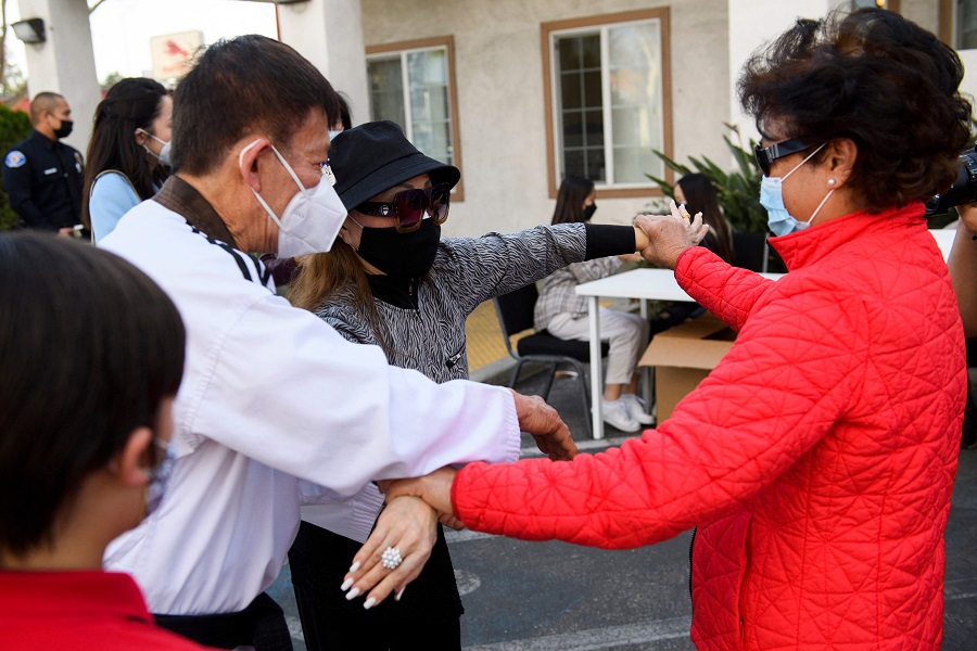 People practice self-defense techniques during a training class in response to hate and violence against Vietnamese and Asian American Pacific Islander (AAPI) people at Advance Beauty College on 23 March 2021 in Garden Grove, California, US. (Patrick T. Fallon/AFP