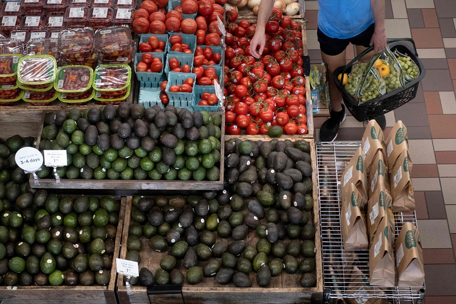 A person shops for produce at an area grocery store on 12 August 2021, in Washington, DC, US. (Brendan Smialowski/AFP)