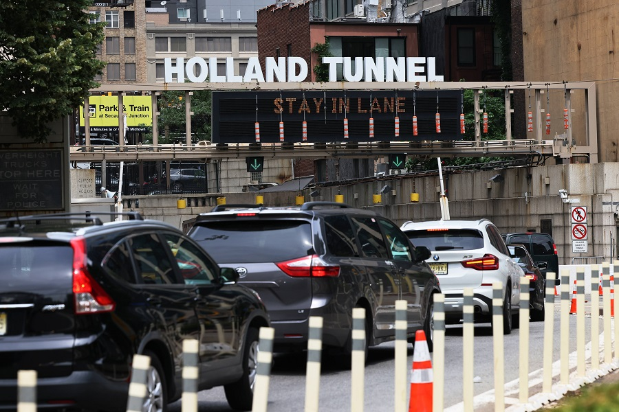 Vehicles wait in traffic to enter Holland Tunnel on 2 July 2021 in Lower Manhattan in New York City, US. (Michael M. Santiago/Getty Images/AFP)