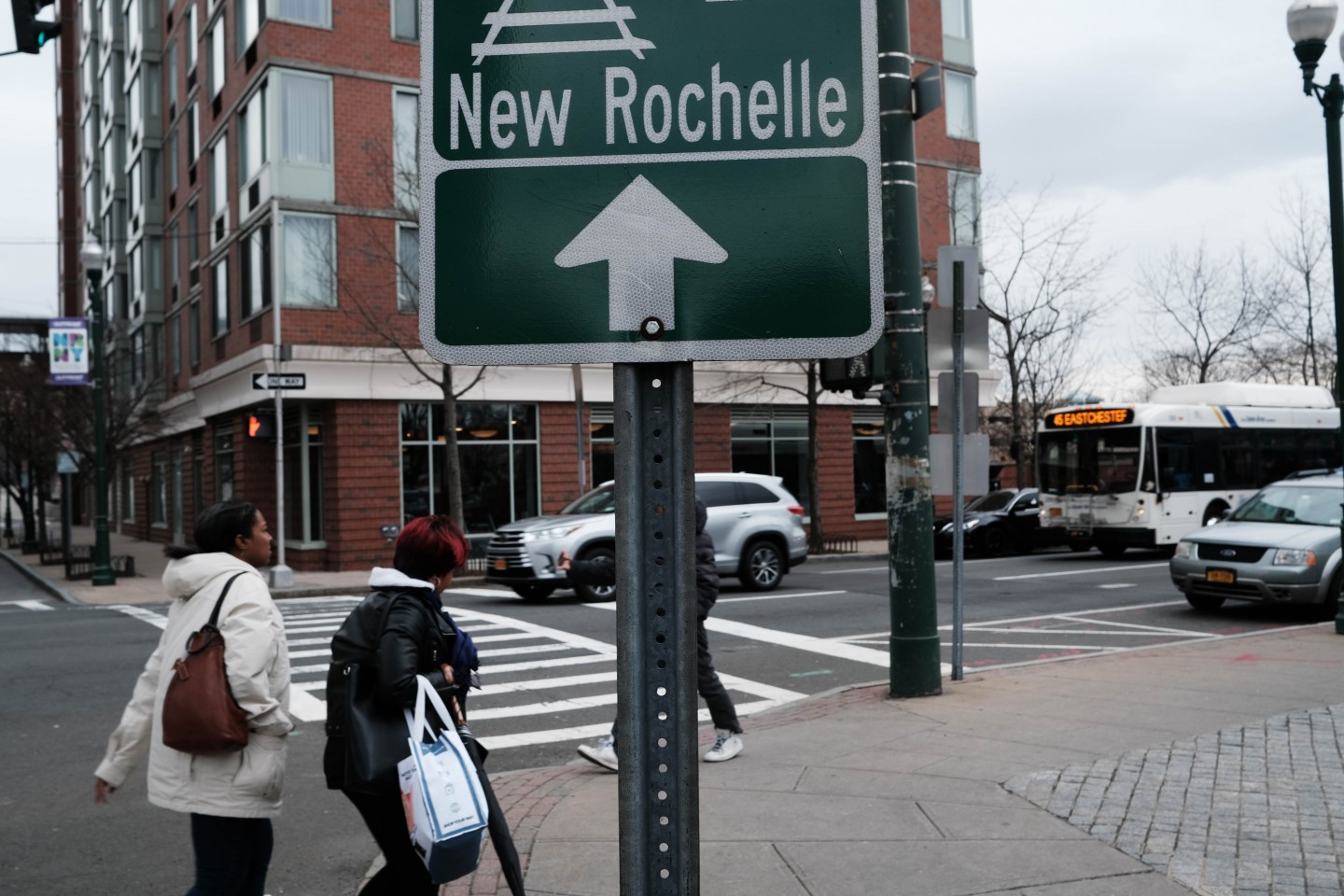 Should Western countries should adopt the lockdown policy? In this photo taken on 10 March 2020, people walk through downtown in New Rochelle, New York. (Spencer Platt/Getty Images/AFP)