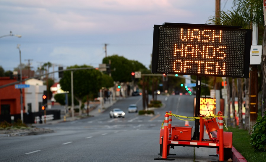 A sign reminds residents to 'Wash Hands Often' on the quiet streets of Monterey Park, California on 26 March 2020 as people stay at home due to the Covid-19 pandemic. (Frederic J. Brown/AFP)