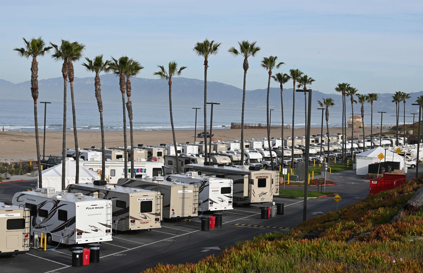 RV campers in a beachside parking lot being used as an isolation zone for people with Covid-19, on 31 March 2020, at Dockweiler State Beach in Los Angeles, California. (Robyn Beck/AFP)