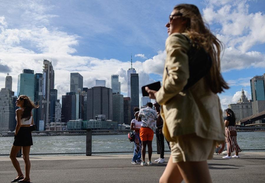 People walk at Brooklyn Bridge Park in New York City, US, on 19 August 2021. (Angela Weiss/AFP)