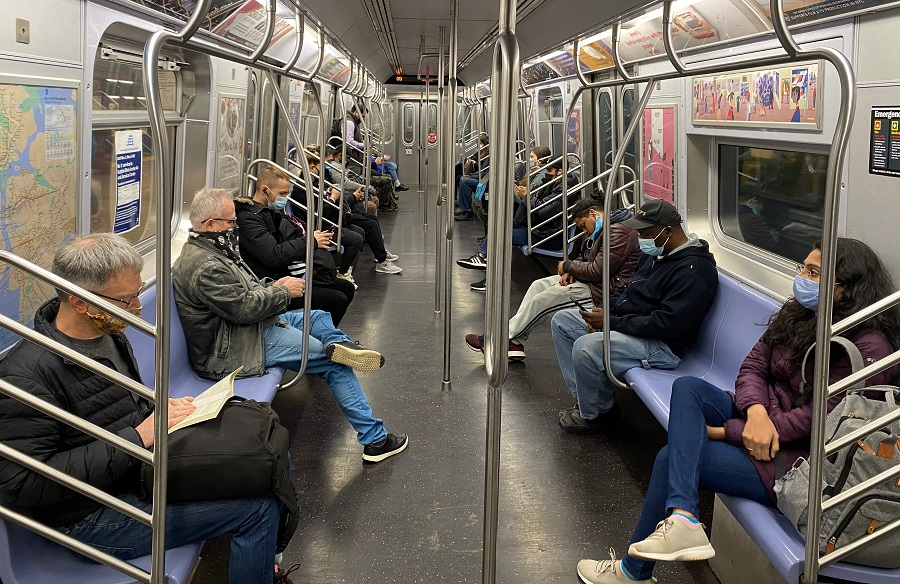Commuters ride the New York City Subway on 5 November 2020, as the coronavirus pandemic continues worldwide. (Daniel Slim/AFP)