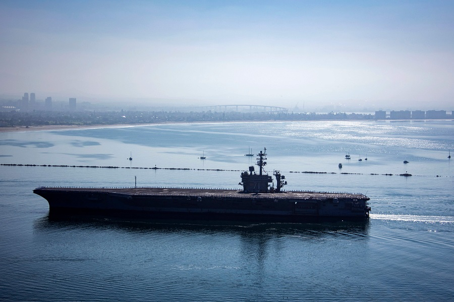 SPH-ID : 35200406 - In this image released by the US Navy, the aircraft carrier USS Theodore Roosevelt returns to Naval Air Station North Island in San Diego, California, on 9 July 2020. (Jessica Paulauskas/US Navy/AFP)
