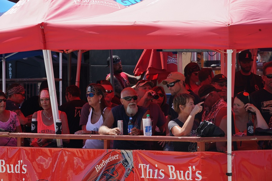 People gather for drinks under a tent on Main Street during the 80th Annual Sturgis Motorcycle Rally on 8 August 2020 in Sturgis, South Dakota. (Bryan R. Smith/AFP)