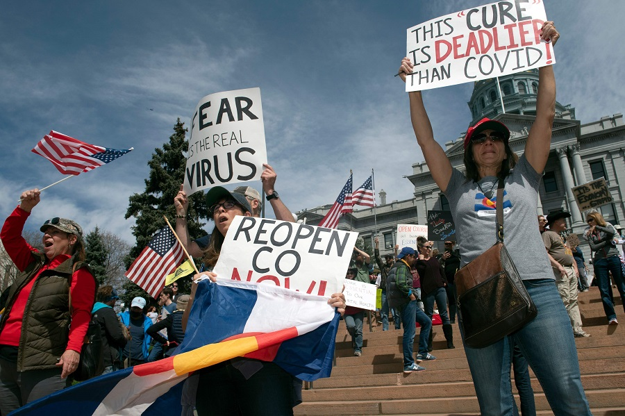 "Demonstrators gather in front of the Colorado State Capitol building to protest coronavirus stay-at-home orders during a ""ReOpen Colorado"" rally in Denver, Colorado, on 19 April 2020. (Jason Connolly/AFP)"