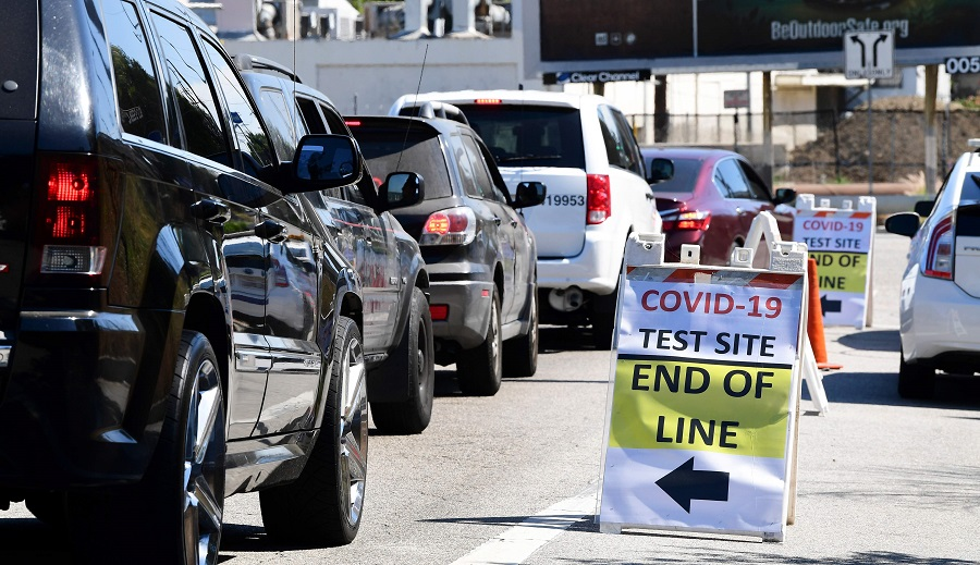 Vehicles make their way to a Covid-19 test site in Los Angeles, California on 21 July 2020. (Frederic J. Brown/AFP)