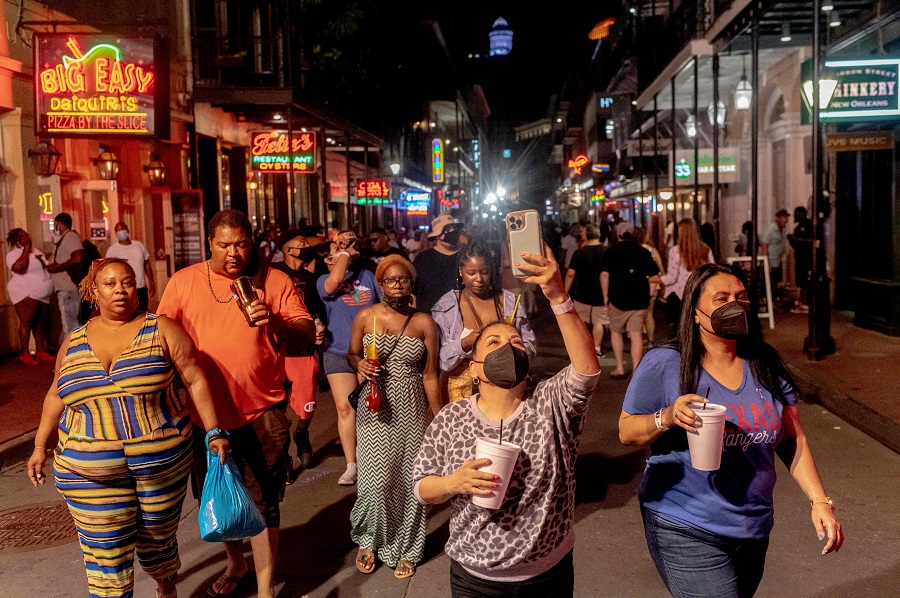 Partygoers on Bourbon Street in New Orleans, US, on 13 August 2021. (Emily Kask/AFP)