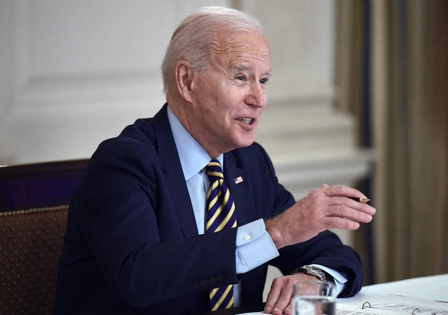 US President Joe Biden speaks during a virtual meeting with members of the Quad alliance of Australia, India, Japan and the US, in the State Dining Room of the White House in Washington, DC, US, on 12 March 2021. (Olivier Douliery/AFP)