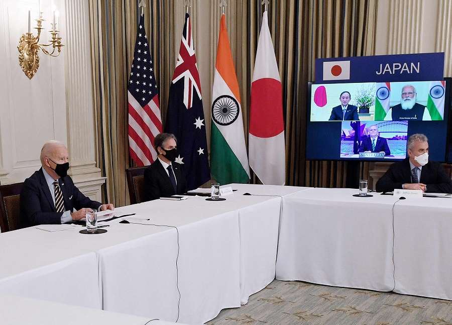 US President Joe Biden (left) and Secretary of State Antony Blinken (second from left) meet virtually with members of the Quad alliance of Australia, India, Japan and the US, in the State Dining Room of the White House in Washington, DC, on 12 March 2021. On screen are Japanese Prime Minister Yoshihide Suga (top left), Indian Prime Minister Narendra Modi (top right) and Australian Prime Minister Scott Morrison (bottom). (Olivier Douliery/AFP)