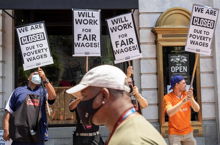 Activists take part in a protest outside of the Old Ebbitt Grill to call for a full minimum wage with tips for restaurant workers in Washington, DC, US on 26 May 2021. (Mandel Ngan/AFP)