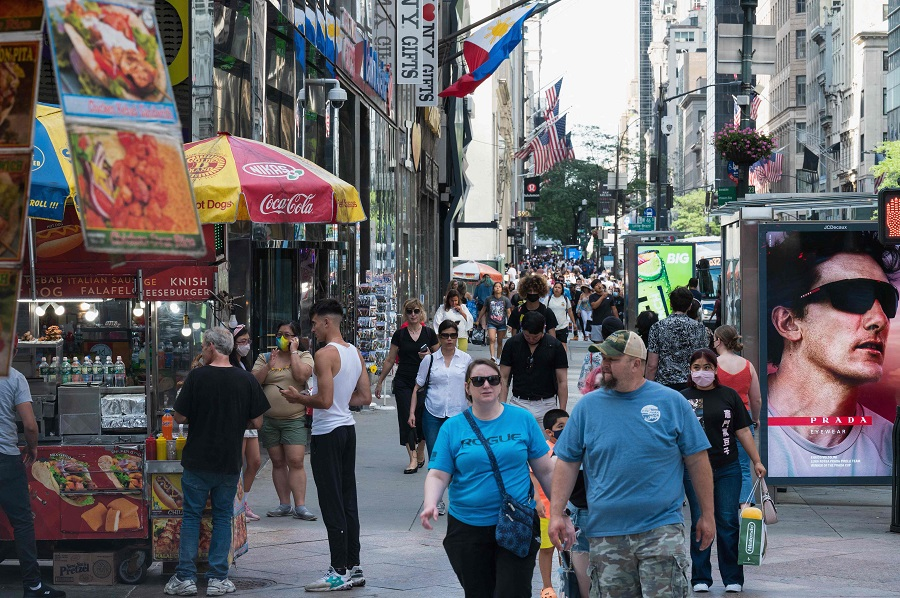 People walk down Fifth Avenue on 25 June 2021 in New York City, US. (Angela Weiss/AFP)