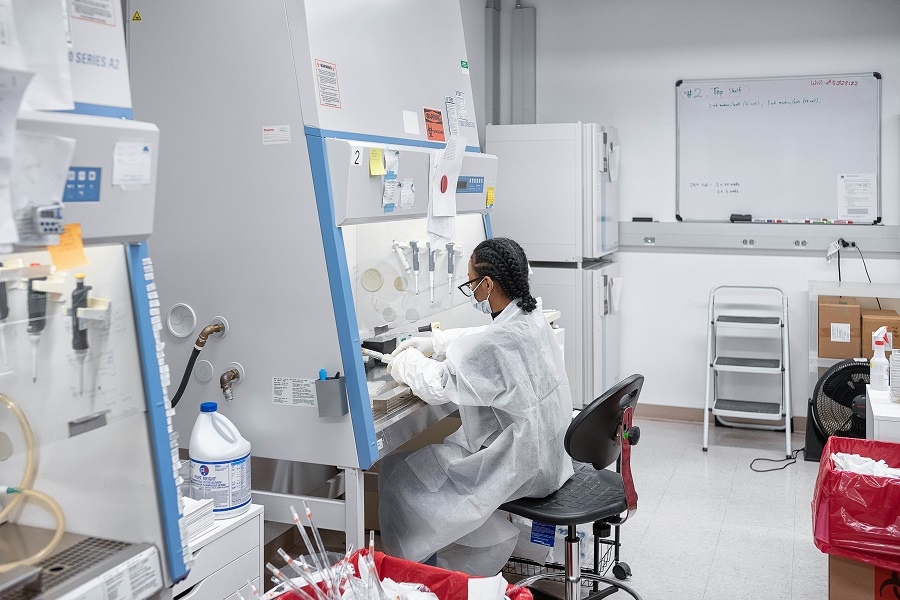 A Mirimus Inc lab scientist works to validate rapid IgM/IgG antibody tests of Covid-19 samples from recovered patients on 10 April 2020 in the Brooklyn borough of New York City. (Misha Friedman/Getty Images/AFP)