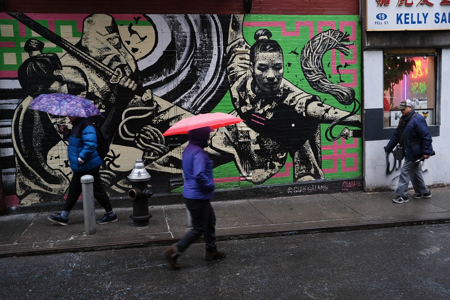 People walk through New York's Chinatown on 13 February 2020. (Spencer Platt/Getty Images/AFP)