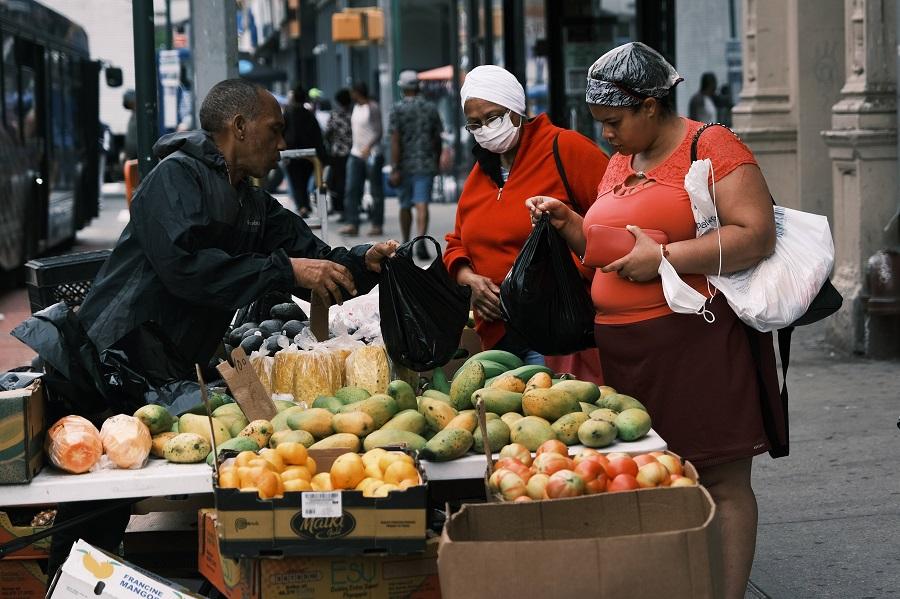 People shop in the Washington Heights neighborhood in Manhattan on 11 June 2021 in New York City, US. (Spencer Platt/Getty Images/AFP)