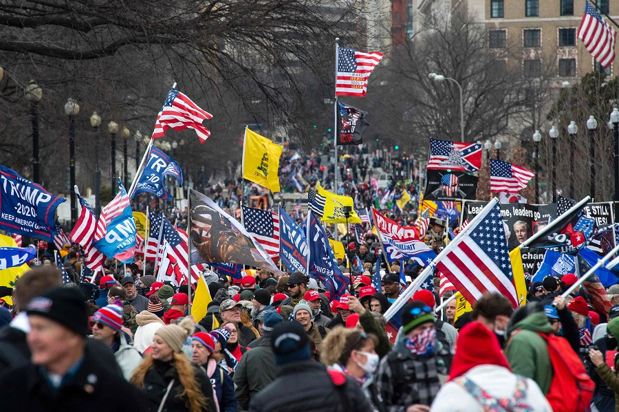 Thousands of supporters of US President Donald Trump march through the streets of the city as they make their way to the Capitol Building in Washington, DC on 6 January 2021. (Joseph Prezioso/AFP)
