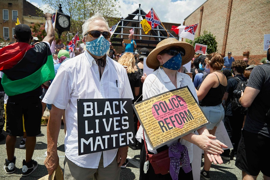 Anti-racism protesters with the Burlington-Alamance March For Justice and Community march in Graham, North Carolina, on 11 July 2020. (Logan Cyrus/AFP)