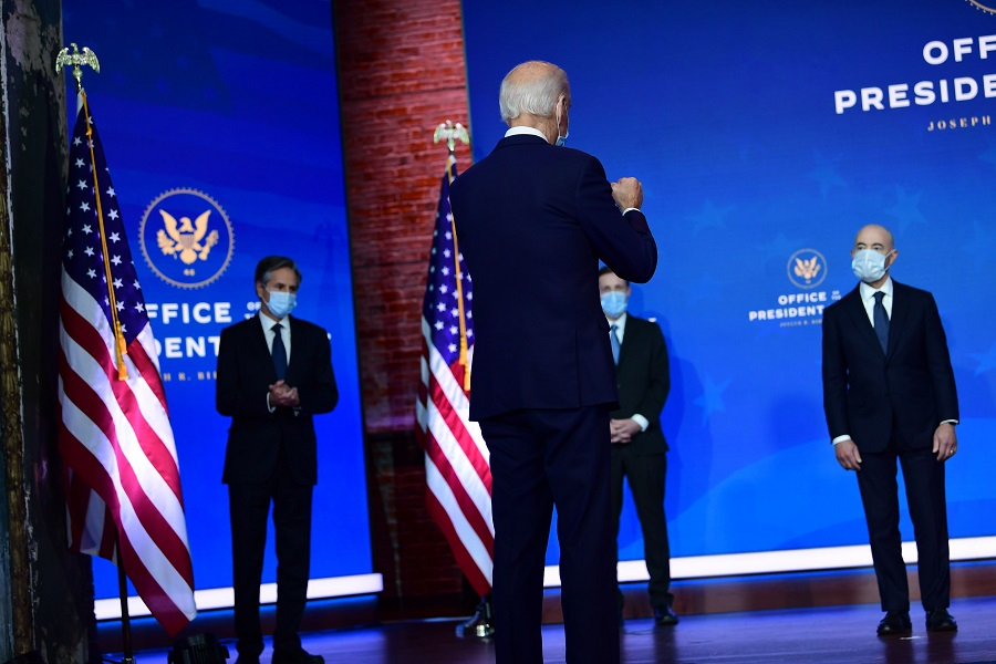 President-elect Joe Biden gestures to key foreign policy and national security nominees and appointments at the Queen Theatre on 24 November 2020 in Wilmington, Delaware. (Mark Makela/Getty Images/AFP)