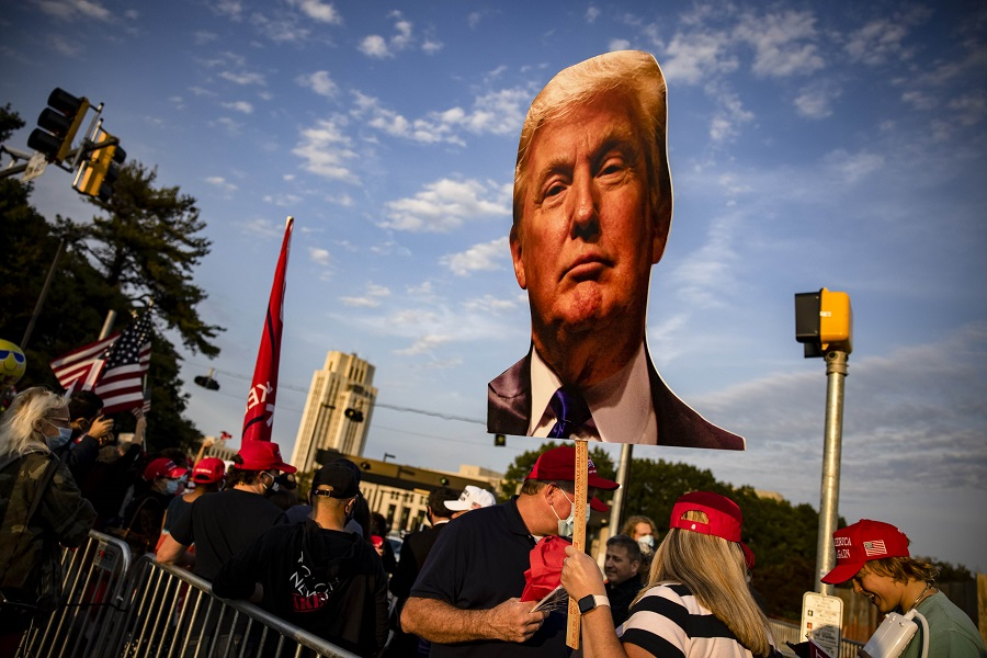 Supporters of US President Donald Trump gather outside of Walter Reed National Military Medical Center after the President was admitted for treatment of Covid-19 on 4 October 2020 in Bethesda, Maryland. (Samuel Corum/Getty Images/AFP)