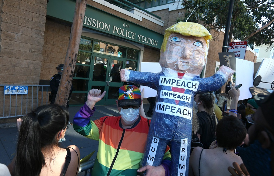 A protester holds a piñata of US President Donald Trump during a demonstration in honor of George Floyd on 3 June 2020 in San Francisco, California. (Justin Sullivan/Getty Images/AFP)
