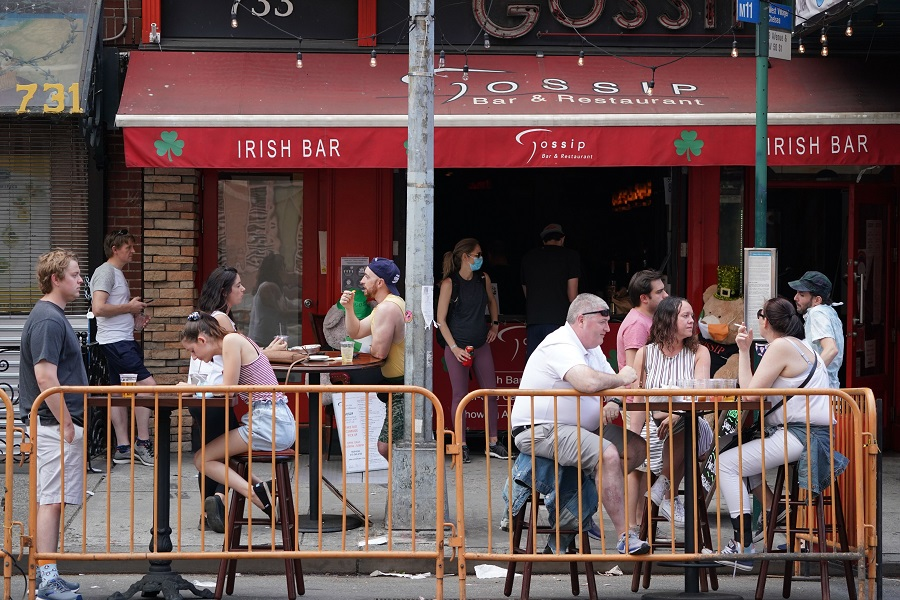 People drink outdoors at bars and restaurants in New York on 7 June 2020. (Bryan R. Smith/AFP)
