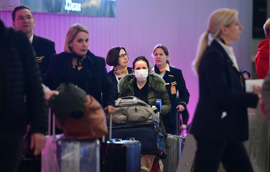 International travellers arrive at Los Angeles International Airport on 12 March 2020, one day before a US flight travel ban hits 26 European countries amid ongoing precautions over the Covid-19 coronavirus. (Frederic J. Brown/AFP)