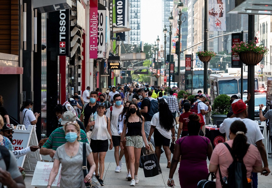People walk through a shopping area in Manhattan on 7 June 2021 in New York City, US. (Angela Weiss/AFP)