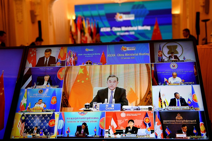 China's Foreign Minister Wang Yi (centre on screen) addresses counterparts from the Association of Southeast Asian Nations (ASEAN) countries in a live video conference during the ASEAN-China Ministerial Meeting, held online due to the Covid-19 novel coronavirus pandemic, in Hanoi on 9 September 2020. (Photo by Nhac Nguyen/AFP)
